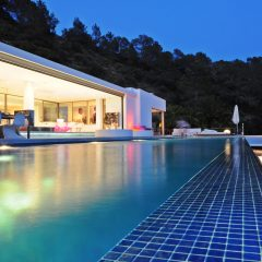 Pool and luxury villa at night in Ibiza