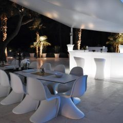 Outdoor dining area in the evening in design villa in San Josep